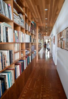 Library hallway!! ~Why not just make your hallway a foot wider and use the space as a built-in library?! Genius plan!!! Genius, I tell you.