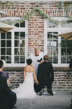 Gorgeous Baby's Breath garland  Historic Rice Mill Wedding | Charleston Weddings | The Wedding Row