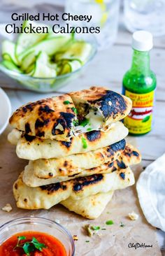 Sharing with you, mini grilled Chicken calzones filled with aromatic, flavorful and spicy chicken, spinach, and oozing cheeses! With delicious flavor of El Yuateco Green Habanero Sauce, these stuff...