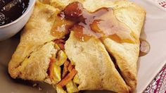 """""""Thai"""" a chicken sandwich up with easy crescent rolls!  Heated chutney finishes off the sandwiches."""