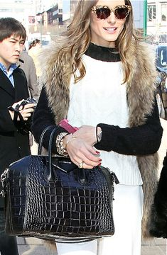 Off to work, carrying her Givenchy bag.