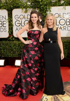 Actresses Tina Fey and Amy Poehler attend the 71st Annual #GoldenGlobe Awards held at The Beverly Hilton Hotel on January 12, 2014 in Beverly Hills, California.
