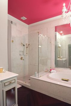 Bathroom: All Is Coming Up Rosy. bathroom color. red ceiling. alcove bathtub. chevron wooden floor. white vanity cabinet. frameless shower door.