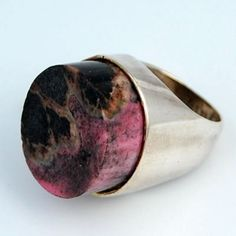 "Stunning and unusual Modernist ring with a gorgeous flat cut oval pink jasper stone. Superb stone with pink, brown and black tones. Marked ""S. SILVER"" (pre 1960)"