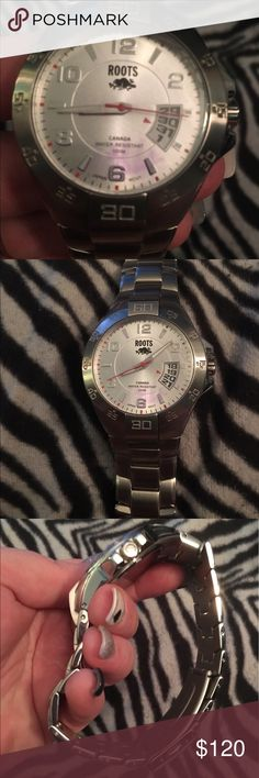 Men's Canada Brand Roots Stainless Steele Men's watch. Canada brand watch Roots. Stainless Steele. Nickel Allergy Free. Water Resistant 100m. NWOT. Doesn't come with a watch box or anything. Still has the clear protective peel on the front and back of watch. All movements work. Roots Accessories Watches