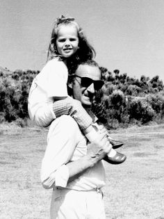 David Niven photographed with his daughter, c. 1960s.