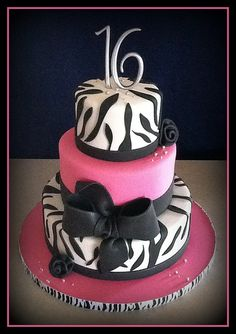 Emily would love this cake! I'm thinking only two tiers though and purple not pink! Perfect