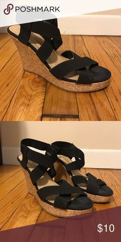 Black strapped wedges Very very comfortable black wedges. The straps are some what of an elastic so they stretch which makes them very easy to wear. They have been worn but are still in pretty good shape. Shoes Wedges