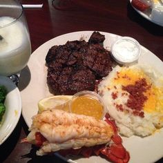 mashed potatoes steak lobster butter ranch dressing cheese bacon bits