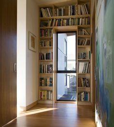 Book shelves around windows... i gotta have somewhere to store all my books
