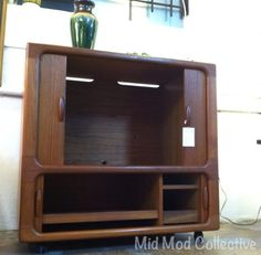 Dyrlund teak cabinet with tambour doors. Available now at Mid Mod Collective. Email midmodcollective@gmail.com for more info. SOLD!