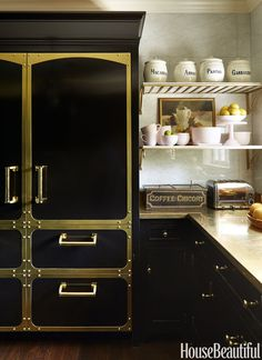 Statement Fridge: This Texas home has a flair for the dramatic, kitchen included. A brass counter and hardware gleam against cabinetry and Sub-Zero refrigerator panels in Benjamin Moore's Onyx. Click through for more designer kitchens. Black Kitchen Cabinets, Kitchen Cabinet Design, Black Kitchens, Interior Design Kitchen, Kitchen Countertops, Cool Kitchens, Cupboards, Metal Countertops, Brass Kitchen