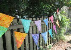 Batik Bunting, Individual Pennants or Flags in Beautiful Batik Fabrics. Outdoor bunting and garden decorations.
