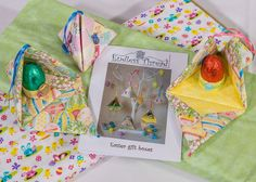 Easter Boxes Pattern and Fabric set from Creative Quilting Two Fat 1/4's of Easter themed fabric and this delightful pattern designed by Gail Penberthy combined exclusively for Justhands-on.tv by Creative Quilting  The pattern for these Easter boxes allows you to make either size and they are large enough to hid a small gift;  and it has been themed with two Fat 1/4's of fabric  - one plain and the other with an #Easter theme.