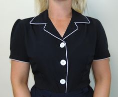 What a fantastic and versatile 1950s diner inspired blouse from our own in-house RocknRomance brand .. Simply perfect for work, play, day or evening .. Easily paired with a simple skirt, high waisted jeans or trousers .. a simple but flattering authentic 1950s diner style cut with contrasting piping to finish it off.. it happily lends itself to styles such as 1950s Rock n Roll, Pin Up, Rockabilly ... this is simply a must have item xx