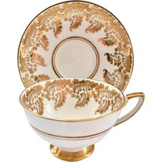 Offering another beauty by Royal Stafford Bone China in this Gold Leaf Design Teacup and Saucer. A detailed motif in gold of large, furling leaves and tiny flowers wraps around this luxurious How To Wrap Flowers, Tiny Flowers, Rose Flowers, Purple Roses, Vintage Dinnerware, Vintage Glassware, Royal Stafford, Bone China Tea Cups, Vintage Cups