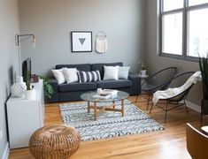 Excel at Extra Seating: Living Rooms With Perfect Pouf Placement — Rooms That Get It Right Decor, White Wainscoting, Room, Living Room Zones, Home Decor, Living Room Wall, Living Room Grey, Interior Design, Gray Living Room Design