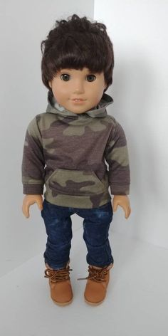 18 inch dolls and clothes Soft light weight camouflage Hoodie for your 18 inch doll. Front pocket and Zipper back closure. Patern used is 123 Mulberry street Local area purchases in coupon area of purchase LOCALPICKUP please contact for pickup My Life Doll Clothes, American Boy Doll, 18 Inch Boy Doll, Chicken Scratch Embroidery, Mulberry Street, Barbie Doll Accessories, Doll Crafts, Girl Dolls, Boy Outfits