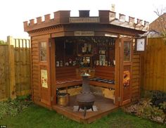 The Rannock is a hand crafted backyard pub shed that features an extensive collection of pub memorabilia.And this wee pub castle has a motorcycle battery to power the pub's lights at night.