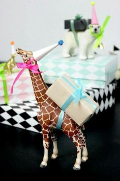 Omg if I got a gift attached to a giraffe, it wouldn't matter what it was. Love it. Always.