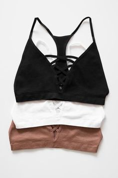 A simple bralette with the criss cross strappy detailing in front and a racerback. Wear it underneath loose-fitting shirts, or even as a yoga top. Made with lightweight knit material that has a good stretch. Available in White, Rust, or Black, 92% Nylon 8% Spandex Imported