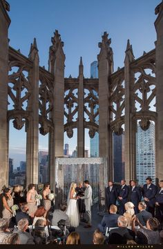 Rooftop Chicago outdoor ceremony at Howells & Hoods the Crown of the Tribune Tower. See more from the Natalie Bomke & Ed Swiderski wedding at http://www.chicagoillinoisweddingphotography.com/category/howells-and-hood-chicago-tribune-tower-wedding/ Photo by Miller + Miller Wedding Photography