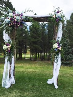 Beautiful blue, pink and lavender  Archway  Enchanted Florist Taos - Taos, NM Flower Shop
