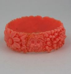 Celluloid bangle from the 1930s with high relief molded flowers, a terrier and an elephant. Japan 1930s