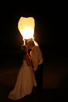 chinese lanterns cool idea for someones wedding- red, yellow, or orange instead of white