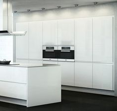 White gloss handleless kitchen design. From the Welford white gloss kitchen range at Kitchen & Bedroom Store. £125 for a 600 base unit supplied rigid.