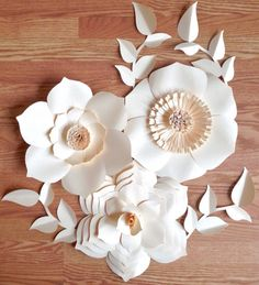 Paper flower backdrop including 3 different paper flower styles and leaves. Each flower is approximately 12. Send a message with your color choice