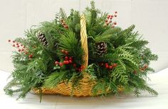 Fireside Greenery Basket - Your Fireplace, Hearth, Entryway or Table will be a perfect spot for this beautiful basket arrangement of natural evergreens. It is filled with Fraser Fir, White Pine, Boxwood, and Cedar that will give off the fragrance of the B (christmas table arrangements)