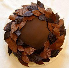 pecan dacquoisecocoa genoiseespresso  buttercreambourbon ganachebelgian bittersweet and milk chocolate leaves