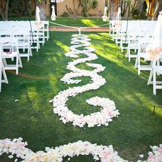 Don't just scatter the flowers! Arrange them down the aisle