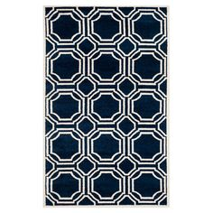 Define an area in your den or master suite with this chic rug, showcasing a geometric motif in navy and ivory.  Product: Rug