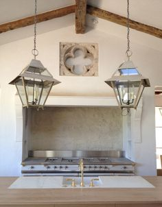 Kitchen with quatrefoil architectural fragment recessed into the wall above the range -- Brooke Giannetti