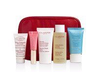 CLARINS Gift Set : 5 PIECES Skin care +Cosmetics Bag (Red) by Clarins. $49.00