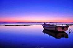 boat on colorful water #photographytalk #waterscape
