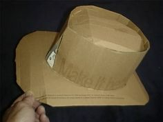 How to Make Your Own Cardboard Cowboy Hat! My husband and I are going to be Doc Holiday and Kate from Tombstone so we finally decided that our son should be a cowboy! It only makes sense! Bought all the other pieces to the outfit like a vest, jeans, sash (red), boots etc.