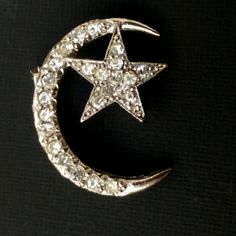 """Antique Rhinestone Paste XL Moon and Star Brooch Antique Rhinestone Paste XL Moon and Star Brooch. Beautiful silver tone brooch with a crescent moon and star all covered with clear instance. Measures approx 1.25"""" x 1.5'. All stones are present. Excellent condition. Vintage Jewelry Brooches"""