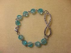 Blingy Infinity bracelet linked with light blue beads-$15