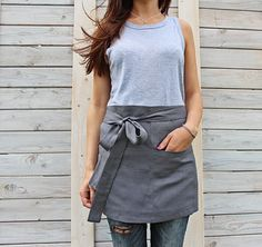This apron is made from 100 % natural linen and produced and handmade by Linen Sky. Functional and long-lasting apron is with two big pockets placed in