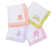 These beautiful white linen cocktail napkins are accented with your monogram (your choice of style) and fringe detail. By Julia B. Couture Linens. Set of 8. Eac
