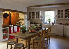 English country kitchen with red aga..