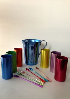 Vintage 1960s Colorful Anodized Aluminum Pitcher, Tumblers and Tea Spoons/ Tallstirs on Etsy, $50.00
