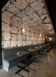 Love the use of the old tin ceiling tiles. And the chairs...