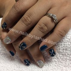 Nail and spray tanning salon in Fullerton, CA. Specializes in gel manicures with nail art and glitter. Book your appointment online at www.nailsbytashad.com Instagram: nailsbytashad Dark blue silver negative space and a rock star nail