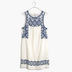 "An easy drop-over-your-head cotton tunic dress with intricate Mexican-inspired embroidery. Tell everyone you picked it up in a faraway market—your secret's safe with us. <ul><li>Shift dress silhouette.</li><li>Falls 35 1/4"" from shoulder.</li><li>Cotton.</li><li>Machine wash.</li><li>Import.</li></ul>"