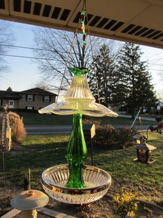 Green and clear glass bird feeder by GardenGlambyKathy on Etsy