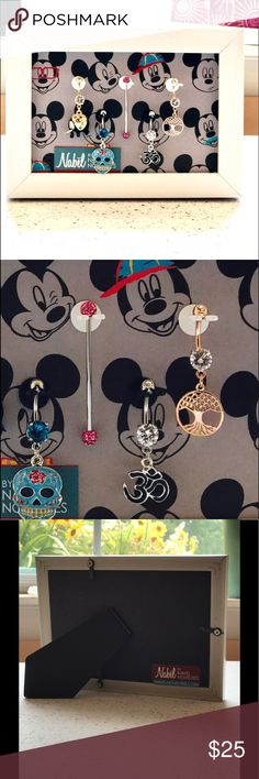Belly Ring Organizer Unique crafted organizer for body jewelry. 4x6 table top frame with 5 Nabel Holders.  Mickey Mouse background.  Holds your precious items securely.  This holder will arrive with 1 free acrylic belly button ring.  Jewelry shown on the display is available for sale. Navel Novelties Accessories